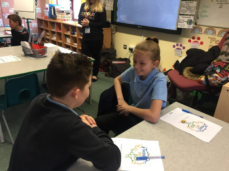 mindfulness for kids - children in a classroom with Rachel Ashcroft doing mindfulness activities